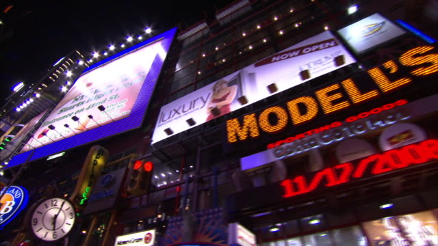 neon lights advertise restaurants, theaters, and an assortment of attractions at times square. - theatre district stock videos & royalty-free footage