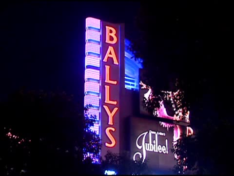 neon lights and signs on strip of las vegas - las vegas replica eiffel tower stock videos and b-roll footage
