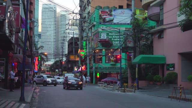 neon lights at makati burgos street at evening. metro manila, philippines - sydostasien bildbanksvideor och videomaterial från bakom kulisserna