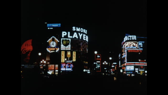 montage neon lights at night in piccadilly circus in london / united kingdom - 1966 stock videos & royalty-free footage