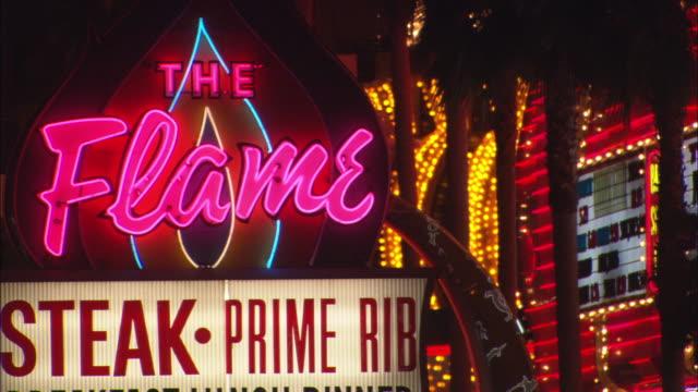 Neon lights flash on restaurants and casinos along Fremont Street in Las Vegas.