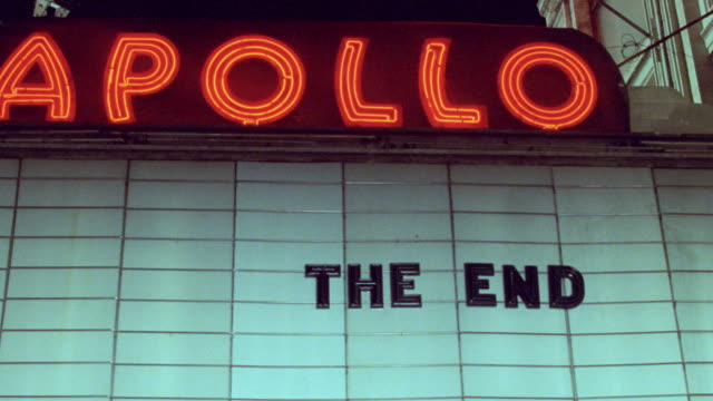neon lights illuminate a sign for the apollo theater in new york city. - the end stock videos & royalty-free footage