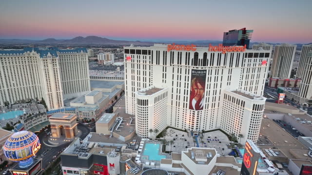 stockvideo's en b-roll-footage met neon lights illuminate signs, hotels, and casinos on the strip in las vegas. - replica eiffeltoren las vegas