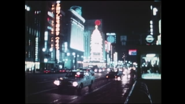 neon lights illuminate the ginza, but less brightly than usual during the oil crisis. - showa period stock videos & royalty-free footage