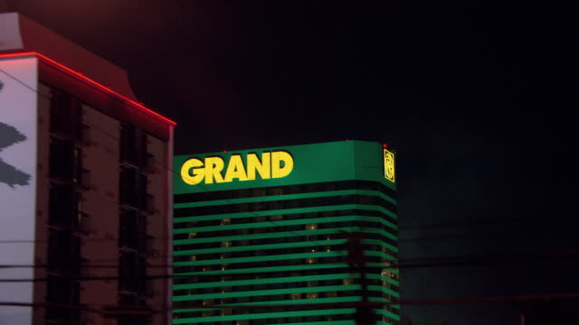 neon lights illuminate the mgm grand in las vegas. - mgm grand las vegas stock videos & royalty-free footage