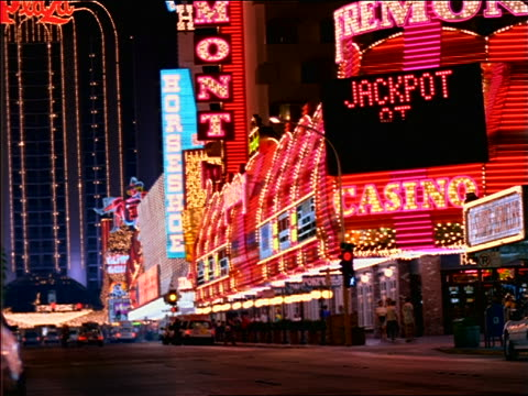 neon lights of casinos on las vegas street at night - cinematography stock videos & royalty-free footage