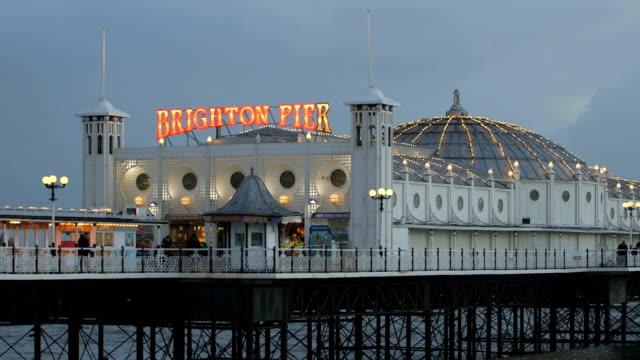 neon lights on brighton pier, uk - brighton england stock videos and b-roll footage