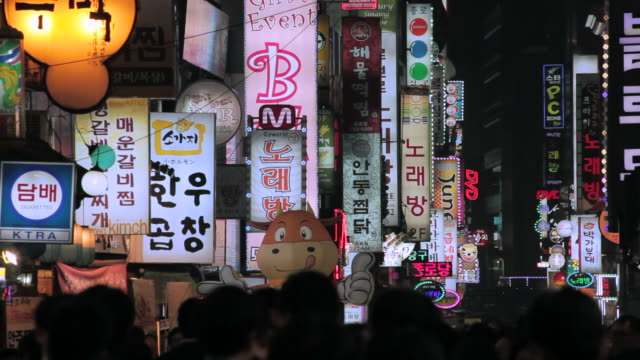 neon lights, restaurant and entertainment district of myeong-dong, seoul, south korea, asia - banner sign stock videos & royalty-free footage