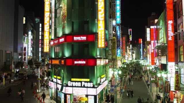 neon lit entertainment street beside jr shinjuku south station, tokyo, japan - bizarre fashion stock videos and b-roll footage