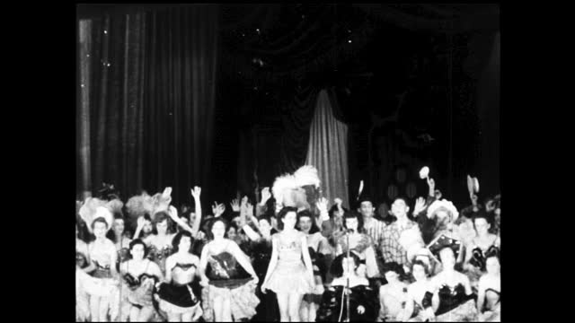"neon marquee in the night: ""lyric western elect. co. club minstrel -- mon. tue. nite 8:30""; people watching in the theatre audience at balcony;... - 1940 1949 stock videos & royalty-free footage"