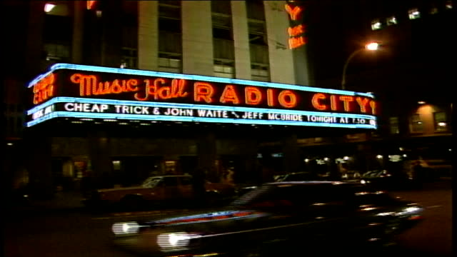 neon marquee of radio city music hall at night - radio city music hall stock videos & royalty-free footage
