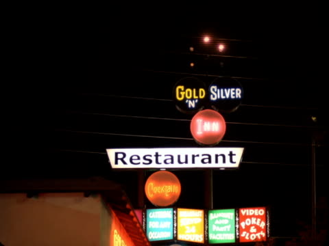 ms, focusing, neon motel restaurant sign at night, reno, nevada, usa - casino sign stock videos & royalty-free footage