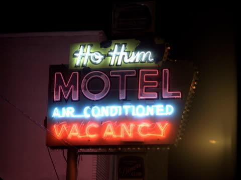 ms, neon motel sign illuminated at night, reno, nevada, usa - motel stock videos & royalty-free footage