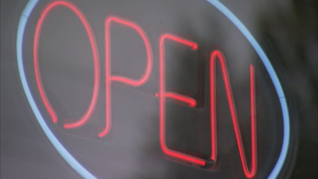 A neon 'open' sign glows. Available in HD.