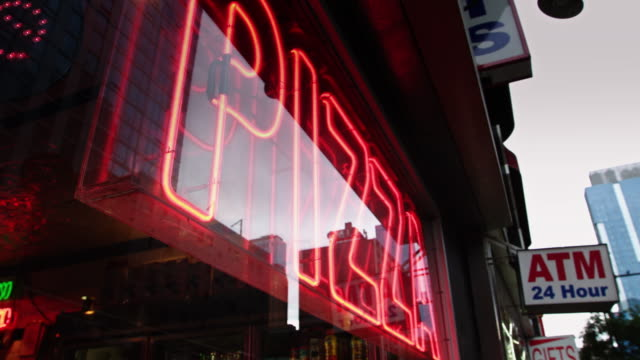 Neon 'Pizza' Sign in Restaurant