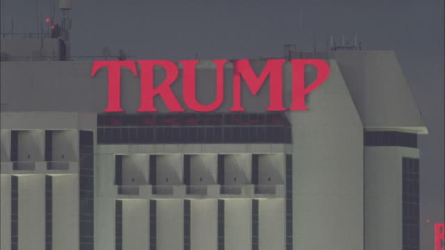 a neon sign advertises the trump hotel and casino in atlantic city, new jersey. - atlantic city stock videos & royalty-free footage