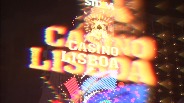 a neon sign flashes as it advertises the casino lisboa in macao, china. - macao stock videos & royalty-free footage