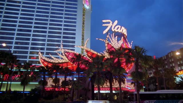 la ws neon sign flashing outside flamingo hilton / las vegas, nevada, usa - flamingo hilton stock videos & royalty-free footage