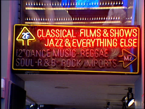 neon sign in nyc tower records directing customers to location of different genres of music - tower records stock videos & royalty-free footage