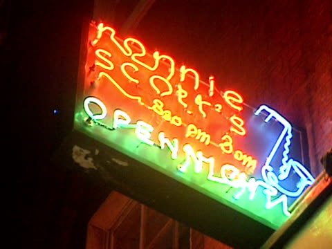 neon sign outside ronnie scott's club - entertainment club stock videos & royalty-free footage