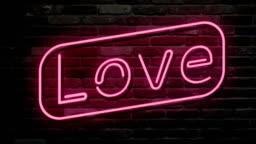 Neon sign, the word Love on dark background. Design element for Happy Valentine