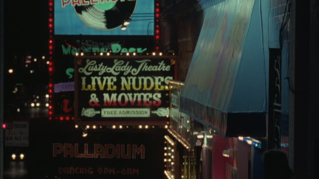 Neon signs advertise XXX Rated Video Movie Arcade and the Lusty Lady Theatre.