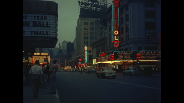 ws neon signs and theater marquees in times square at night / new york city, new york state, united states - new york city 1950s stock videos & royalty-free footage
