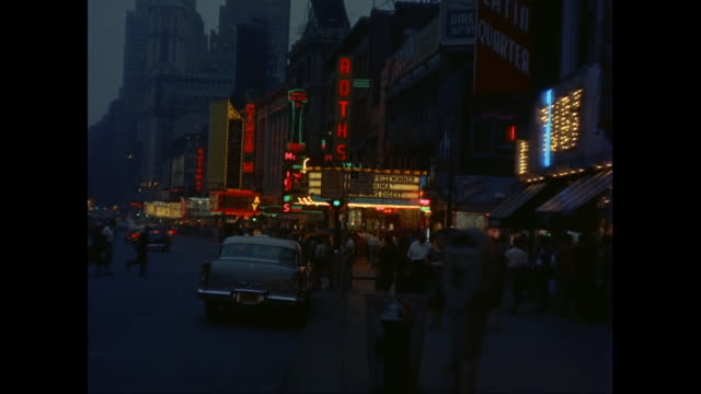 vidéos et rushes de ws neon signs and theater marquees in times square at night / new york city, new york state, united states - manhattan