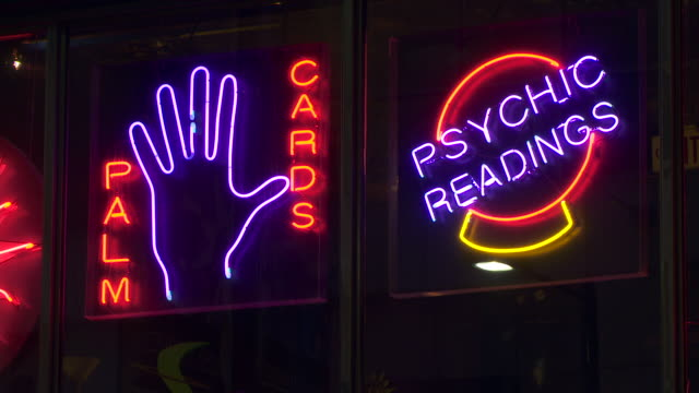 neon signs at night.  palm cards and psychic readings. - fortune telling stock videos & royalty-free footage