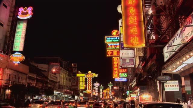 WS ZI Neon signs at Th Yaowarat in Chinatown at night / Bangkok, Thailand