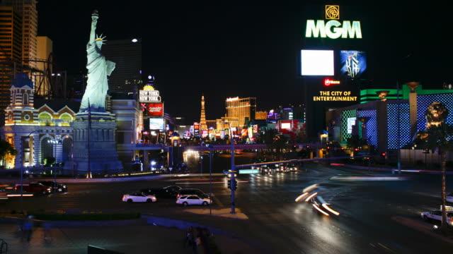 neon signs flash and illuminate las vegas boulevard. - the strip las vegas stock videos & royalty-free footage