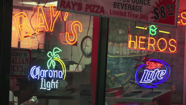 neon signs in a pizza house window - identity stock videos & royalty-free footage