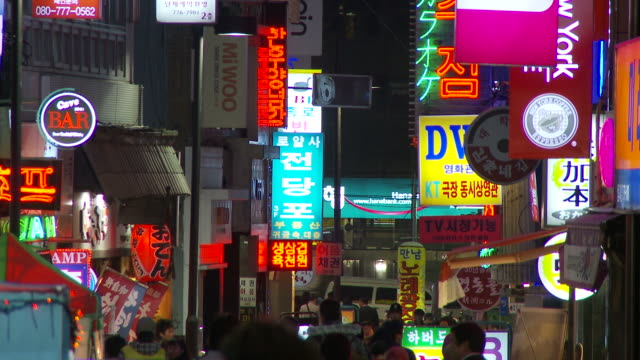 Neon signs in shopping district in Seoul South Korea