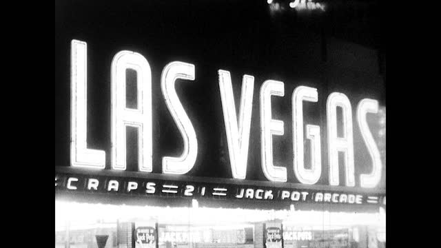 """neon signs in the night """"golden nugget gambling hall"""" """"gambling"""" """"las vegas jackpot arcade""""; people walking on the sidewalk across the street - black and white stock videos & royalty-free footage"""