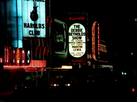neon signs marquees facades for harold's club harrah's advertising the debbie reynolds show with martin lewis / arching 'reno biggest little city in... - horseshoe stock videos and b-roll footage