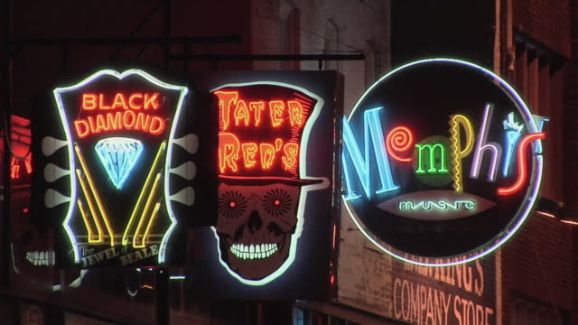 CU ZO Neon signs of establishments in Beale street / Memphis, Tennessee, USA
