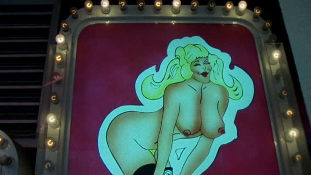 vidéos et rushes de / neon signs on front of strip joint in downtown montreal / cu of sign featuring topless woman exterior montreal strip club on january 01 1980 in... - peep show