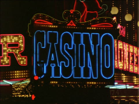 neon signs on street in las vegas at night - 2001 stock videos and b-roll footage