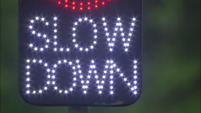 ecu, neon slow down sign, united kingdom - speed limit sign stock videos & royalty-free footage