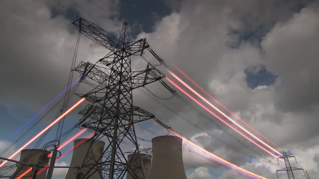gfx neon sparks running through electricity pylons - medium shot stock videos & royalty-free footage