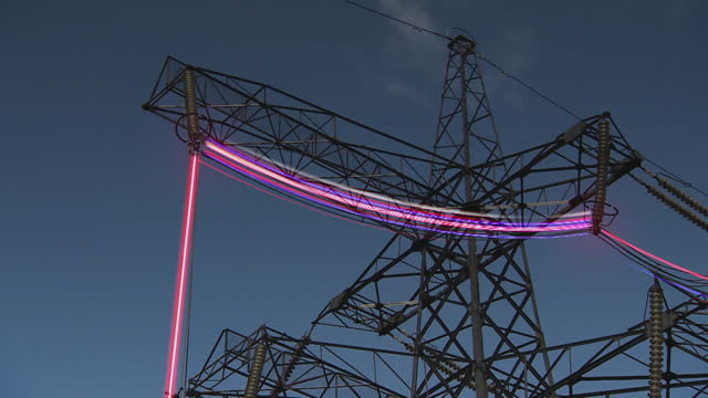 gfx neon sparks running through electricity pylons - less than 10 seconds stock videos & royalty-free footage