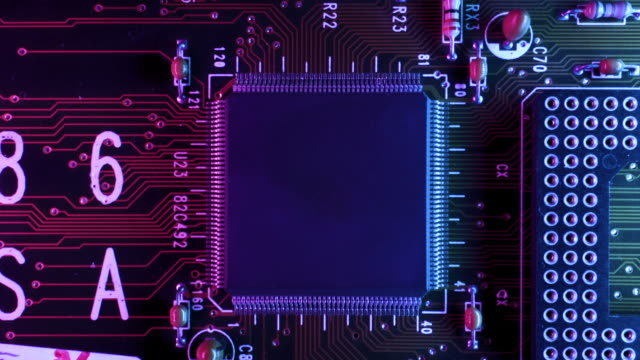 vídeos de stock e filmes b-roll de neon themed circuit board inside of a computer cpu from above - interior