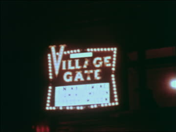 """1969 neon """"village gate"""" sign at night / greenwich village, nyc / industrial - greenwich village stock videos & royalty-free footage"""