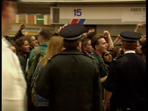 neonazis and antifascists fighting in and around waterloo england london waterloo station bv police with alsatian police dogs move in on rowdy... - anti fascism stock videos & royalty-free footage