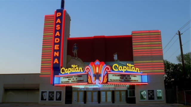 ms  neons on movie theater - theatre banner commercial sign stock videos & royalty-free footage