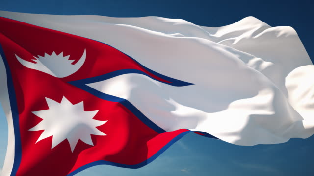 4k nepal flag - loopable - nepali flag stock videos & royalty-free footage