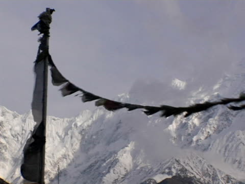ms, pan, nepal, jomsom, tibetan buddhist prayer flags with snow capped annapurna mountains in background - annapurna range stock videos and b-roll footage