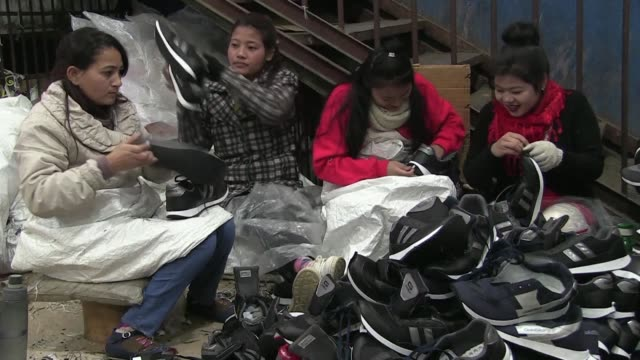 nepal made goldstar shoes were an icon of the country's brutal maoist insurgency when simply wearing a pair was enough to be accused of... - maoism stock videos & royalty-free footage