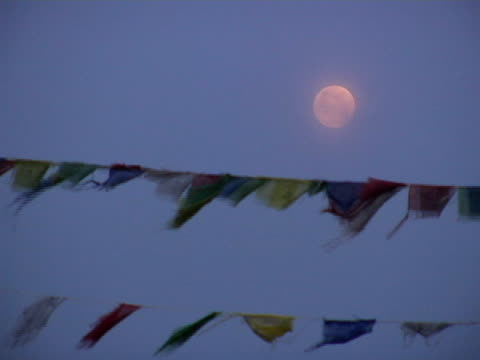 CU, Nepal, Pokhara, Full moon above Tibetan Buddhist prayer flags