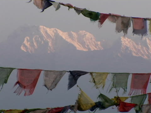CU, Nepal, Pokhara, Tibetan Buddhist prayer flags with snow capped Annapurna mountains in background